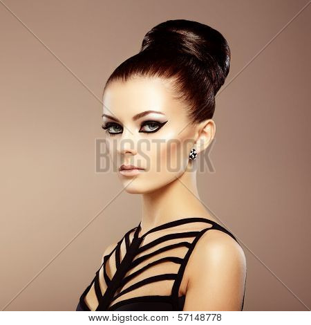 Portrait of beautiful sensual woman with elegant hairstyle. Perfect makeup. Fashion photo poster