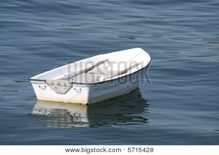 A lonely white row boat