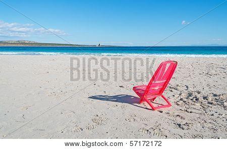 Red Chair In La Pelosa