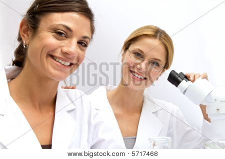 Two Femal Scientists Working Together