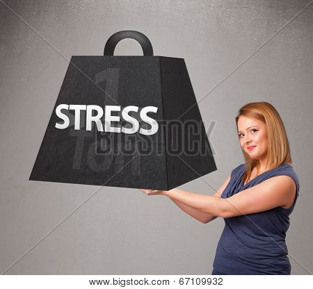 Attractive young woman holding one ton of stress weight