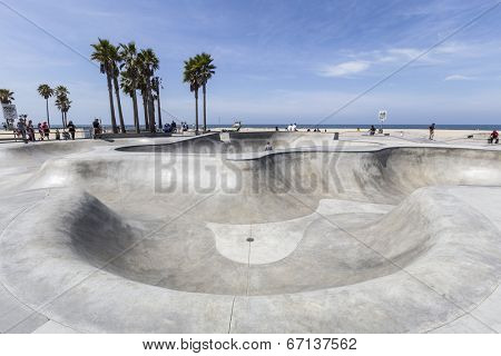 VENICE BEACH, CALIFORNIA - JUNE 21 : Deep concrete ramps and palm trees at the popular public skate board park at Venice Beach on June 21, 2014 in Los Angeles, California.