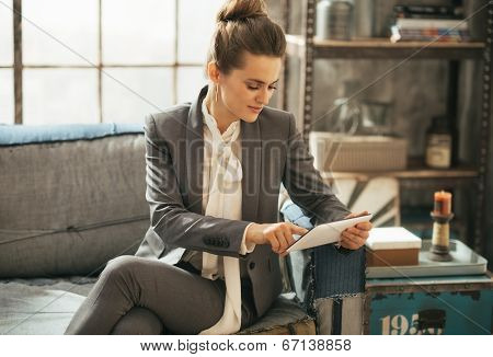 Happy Business Woman Using Tablet Pc In Loft Apartment