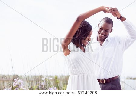 Romantic couple dancing and smiling outside in the garden