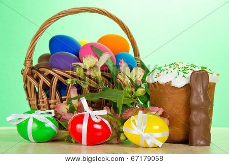 Basket, eggs, an Easter cake, rabbit, alstromeria
