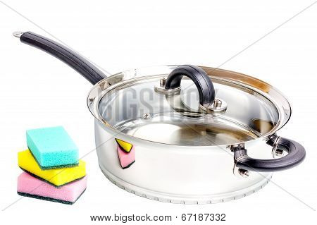 Stainless Steel Deep Stewing Pan With Sponges On White Background
