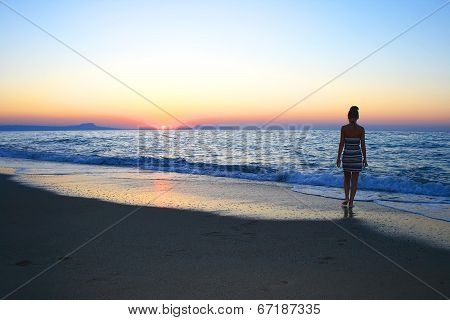 Woman As Silhouette On The Beach