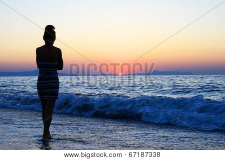 Young Woman As Silhouette By The Sea