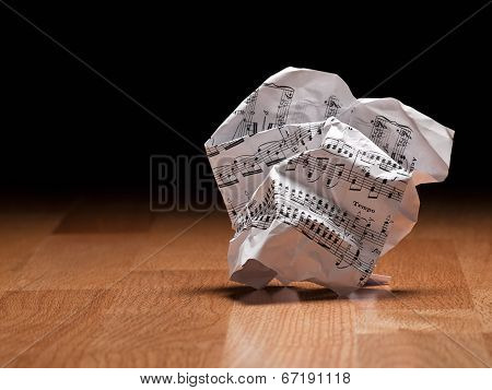 Sheet Of Music Notes Crumpled On The Floor