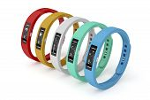 Fitness trackers with different interfaces and colors poster