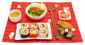 big set of traditional japanese food with chopsticks and flowers poster