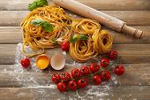 Still life with raw homemade pasta and ingredients for pasta poster