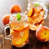 jar of peach tea with striped straw poster