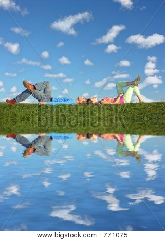 couple lies under clouds and water