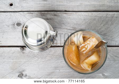 Vietnamese Ice Coffee With Condensed Milk, Cafe Sua Da On A Wooden Background