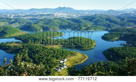 Fantastic landscape of eco lake for travel at Dalat Viet Nam fresh atmosphere villa among forest impression shape of hill and mountain from high view wonderful vacation for ecotourism in spring poster