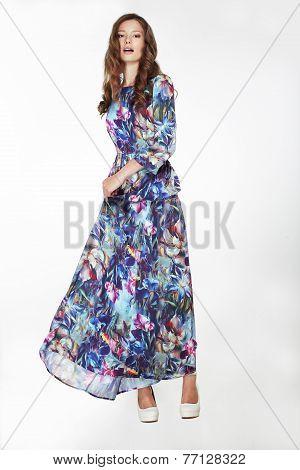 Elegant Fashionable Female In Silky Blue Flowery Dress