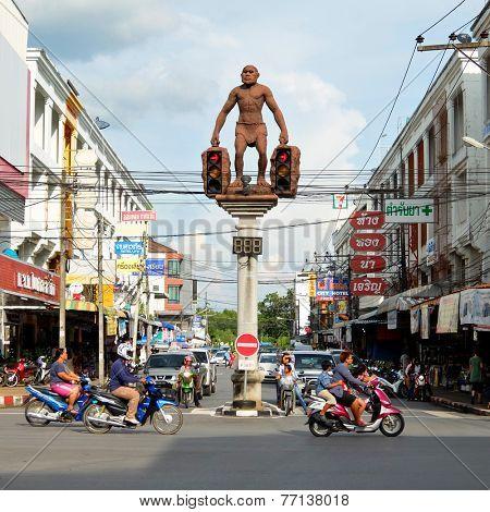 29 November, 2014: Street art, Statue of Neanderthal man, unusual traffic lights in Krabi town, Thailand