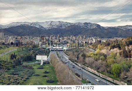 City Of Tehran And Its Highways And Skyline In Front Of Alborz Mountains
