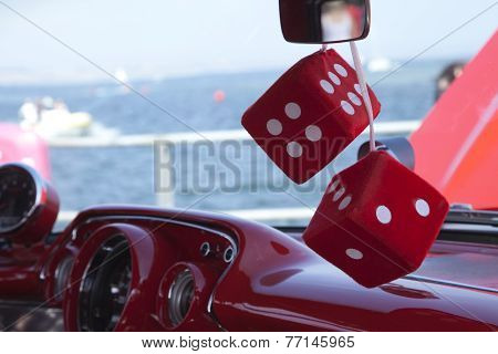 Fluffy red dice on a dash board