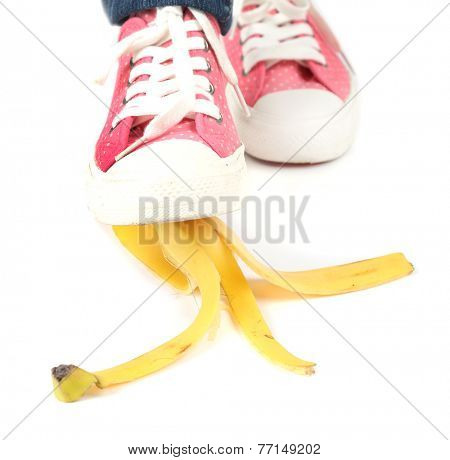 Shoe to slip on banana peel and have an accident, isolated on white poster
