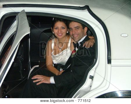 bride and groom off to their honeymoon in a limousine. poster