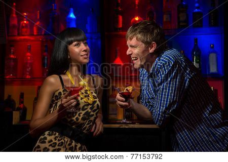 Couple at the bar having drinks