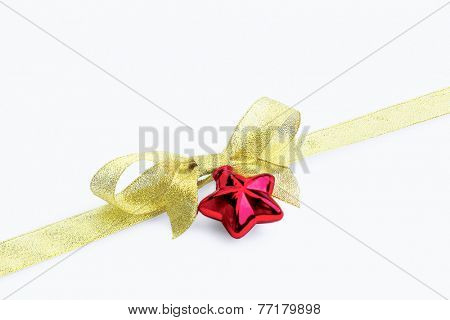 ift golden ribbon and bow isolated on white.