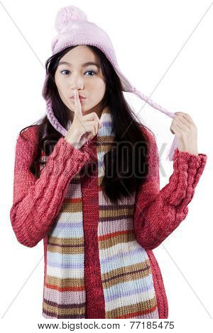 Lovely Girl With Finger On Lips