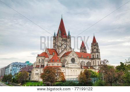 St. Francis of Assisi Church in Vienna Austria ona cloudy day poster