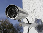 Surveillance infra red camera mounted on wall poster