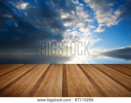 Stunning Landscape At Sunset Reflected In Ocean With Wooden Planks Floor