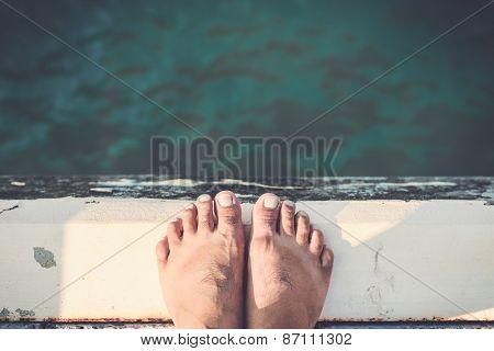 Bare Feet Standing On Cement Edge