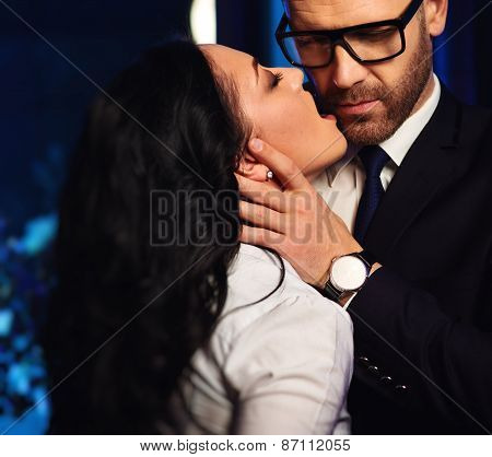 Couple Close-up. Sensual Brunette Seduce Handsome Businessman. Office Romance Concept