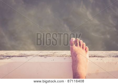 Bare Foot Standing On Cement Edge