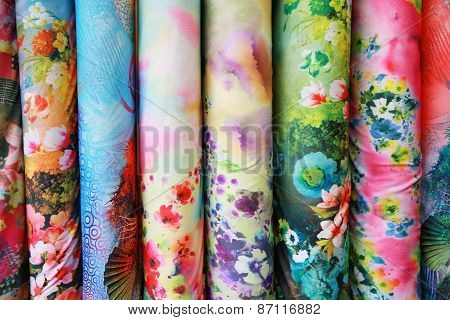 A variety of different bolts of colorful silk fabric