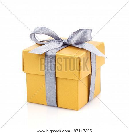 golden gift box with silwer ribbon