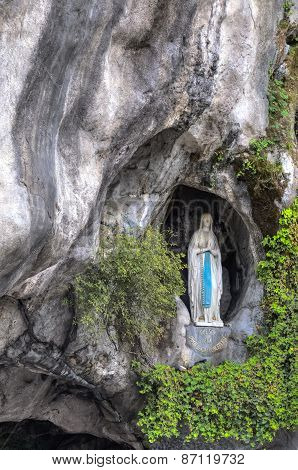 The Rock Cave At Massabielle With The Statue Of The Virgin Mary
