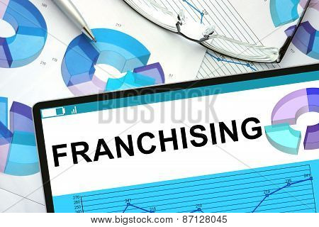 Franchising on tablet with graphs.