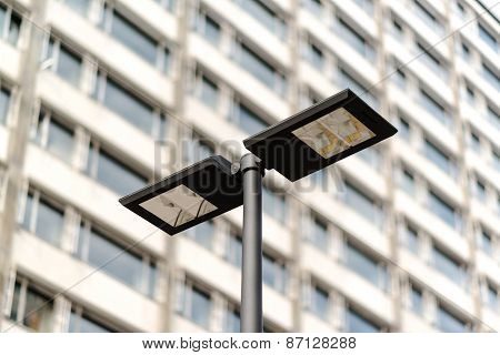 Modern streetlamp and concrete building