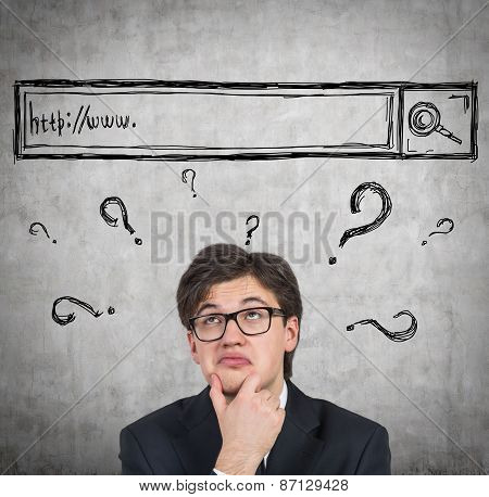Young man is trying to find some answers in the internet. poster