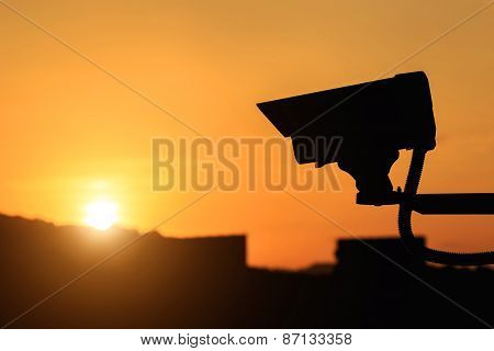 Silhouette Of Security Cctv Camera With Sunset Background