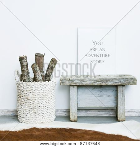 wooden frame YOU ARE AN ADVENTURE STORY. Hipster scandinavian style room interior. Busket with firewood and a cow rug on the floor poster