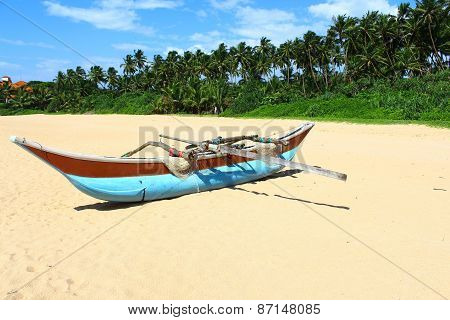 Boat local fishermen on the beach in Bentota, Sri Lanka poster