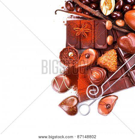 Chocolates border isolated on white background. Chocolate sweets. Assortment of fine chocolates in white, dark, and milk chocolate. Variety of Praline Chocolate candies