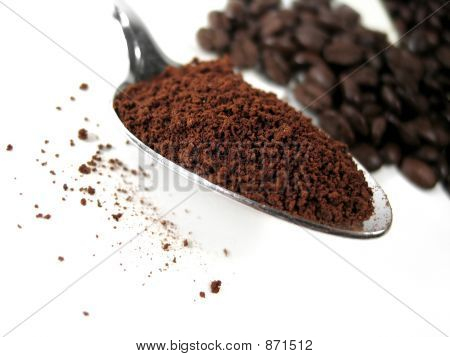 coffee beans and ground coffee : transition. focus on spoonful of ground coffe. poster
