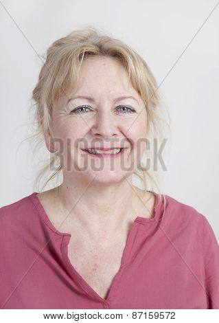 an older woman with blond hair is happy studio portrait poster