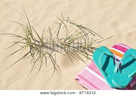 Beach Grass Towel And Flip-flops.