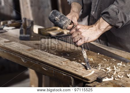 Hands Of Carpenter Plane At Work