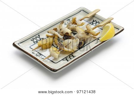 grilled skewered whelks, japanese food isolated on white background
